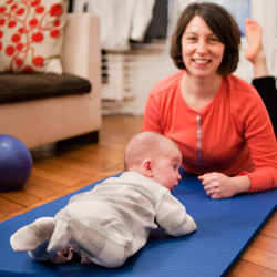 Emily Mazo-Rizzi & her baby daughter practicing Pilates